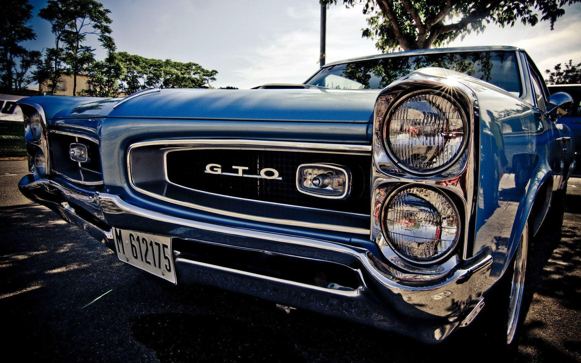 Pontiac GTO headlights shining from the sun